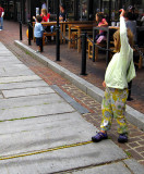 Ollie and Rosie volunteer to be part of the busker's show at the Quincy Market
