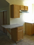 Kitchen cabinets, counter, fan