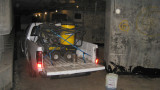 Graffiti cleaning truck with hot water blasting rig parked in main corridor