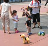 HK_Disneyland_Kid_with_Toys