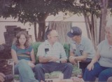 Judy Is Mike's wife.  Uncle Ted is Leonard Franklin Collins Jr.  Uncle Russell is Russell Roy Sharp Jr.  Mom is Catherine Frances (mn) Sharp Knapp.  This photo on paper was taken in the  backyard of our home in Sheldon, California  8770 Grantline Road Elk Grove California 95624