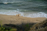 Ka'alawai beach surfer