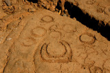 Circles and moon petroglyph
