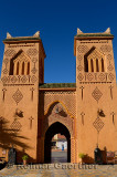 Traditional Berber pise towers made of red adobe and blue sky at desert resort