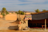 Berber tent and palm trees at the edge of the desert in Khemlia Morocco