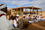 Pigeons du Sable Gnawa musici group in white turbans and jellabas playing in Khemliya Morocco
