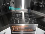 piano in acciaio inox con piani cottura.jpg