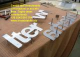 scritta insegna lettere in acciaio inox su mirsura Canton Ticino