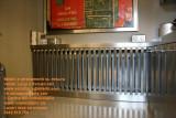 Griglia in acciaio inox per copricalorifero bar locale arredo