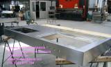 Top cucina inox in costruzione con vasca saldata e cottura a Sondrio