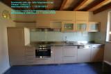 Arredamento su misura per cucina realizzata dalla Falegnameria Dego Giovanni con top inox .JPG
