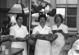 SCS Kitchen Staff with health food for the 1960/70's students