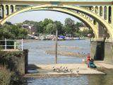 Canoeist portaging through Richmond lock.