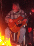 Keith plays by the fire
