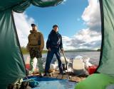 Valera and Lesha on duty while sailing by the Kureika river