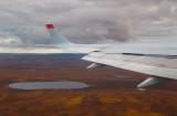 TUpolev-204 over tundra