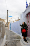 Santorini. Village of Pirgos. An elderly woman invite us to visit Venetian castle