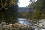 15.  The covered bridge below the grist mill