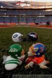 NFL Huddles: NY Jets & Denver Broncos huddles figures at Invesco Field in Denver