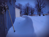 Sidewalk (unshoveled) from parking area to the house. Pump house on left. (2/2/11 evening)
