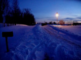 Plowed street from our mailbox (left) out towards highway. (See summer view,same shot, in Iowa Gallery.)