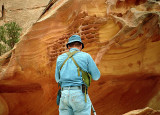 W. photographing Pitted Sandstone - Utah