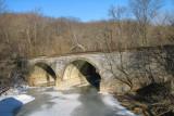 Frozen Catoctin Creek under railroad bridge