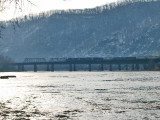 Freight train crosses the Potomac as the sun rises