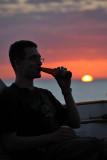 Enjoying a beer at sunset