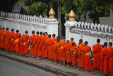Monks collecting alms at early morning