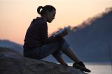 Sunset reading at Mekong River