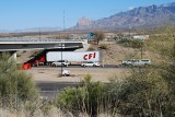 THE CARS AND TRUCKS WAIT IN LINE TO CLEAR THE CHECKPOINT