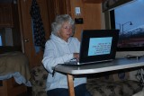SARA KEEPS UP WITH FRIENDS AROUND THE NATION USING HER OWN COMPUTER BY SENDING MANY E MAILS WHEN POSSIBLE