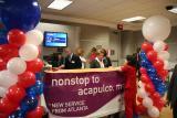Gate activity prior to inaugural Delta flight from Atlanta to Acapulco