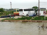 Waiting to Board Buses for Bucharest (River is Very High)