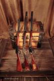 Gun Trio across old chest 3986