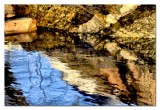 reflections by a rock....