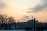 Setting Sun Behind The Cloud