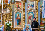 Orthodox Church Iconostasis And Priest