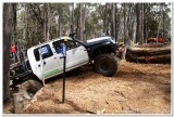 Ramming the Rear Wheels into the Log for more traction