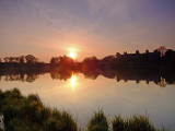 The rising sun,reflecting in The Mere / 2