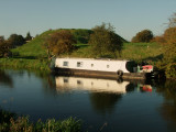Canal  boat  reflected  on  the  River  Nene.