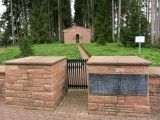 just outside the village, a well-kept German military cemetery...