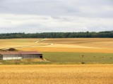 ...overlooking fields of corn and other grains
