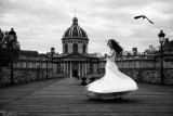 B&W Rolling in wedding dress on the Pont des Arts- Andreea