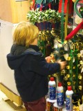 More holiday fun...this kid was ringing bells in a store. He looks a bit like the other boy without the hat!