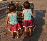 Little girls and caged sparrows-Sisowath Quay