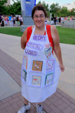 Becky and her friends wear aprons to display their swap cards.