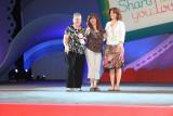 Denise Waddell (center) on stage for her 20 year award as demonstrator. Denise is Gina's direct upline.