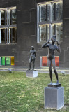 Naked women mock the passerby.